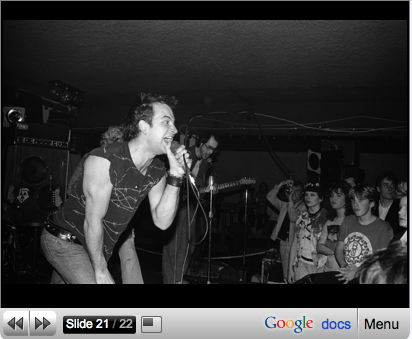 Young Dave O look at camera as The Spores play Bumper's in Surrey 1983